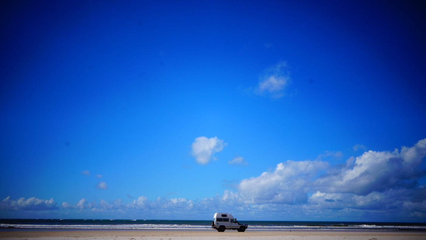 Troopy Travels // Chasing Sunsets From Byron Bay To The Ningaloo Reef, Alice Forrest, Stradbroke Island-QLD, photo by Angel Grimaldi, sand, sky, van, off road, 4WD, empty, expanse