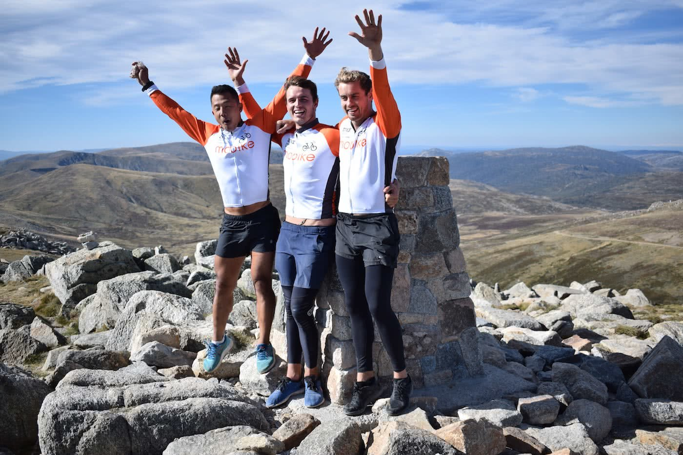 City2Summit // Blood, Sweat and 3 Lousy Gears, James Hackney, mount kosciuszco, trig point, waving, rocks, view