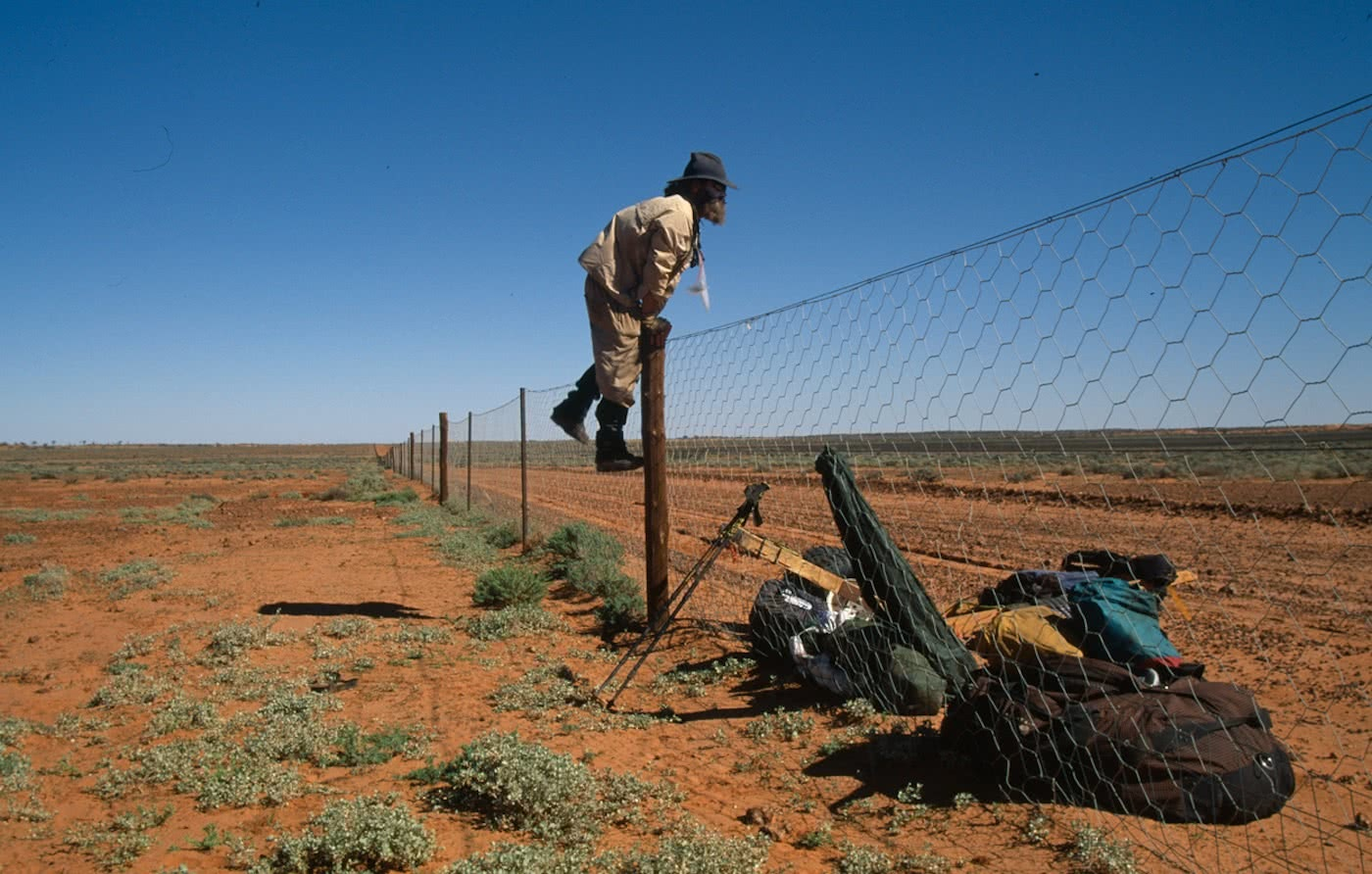 Off the grid A night with Jon Muir Jon_Muir_crossing_a_dingo_fence_during_his_traverse_across_Australia