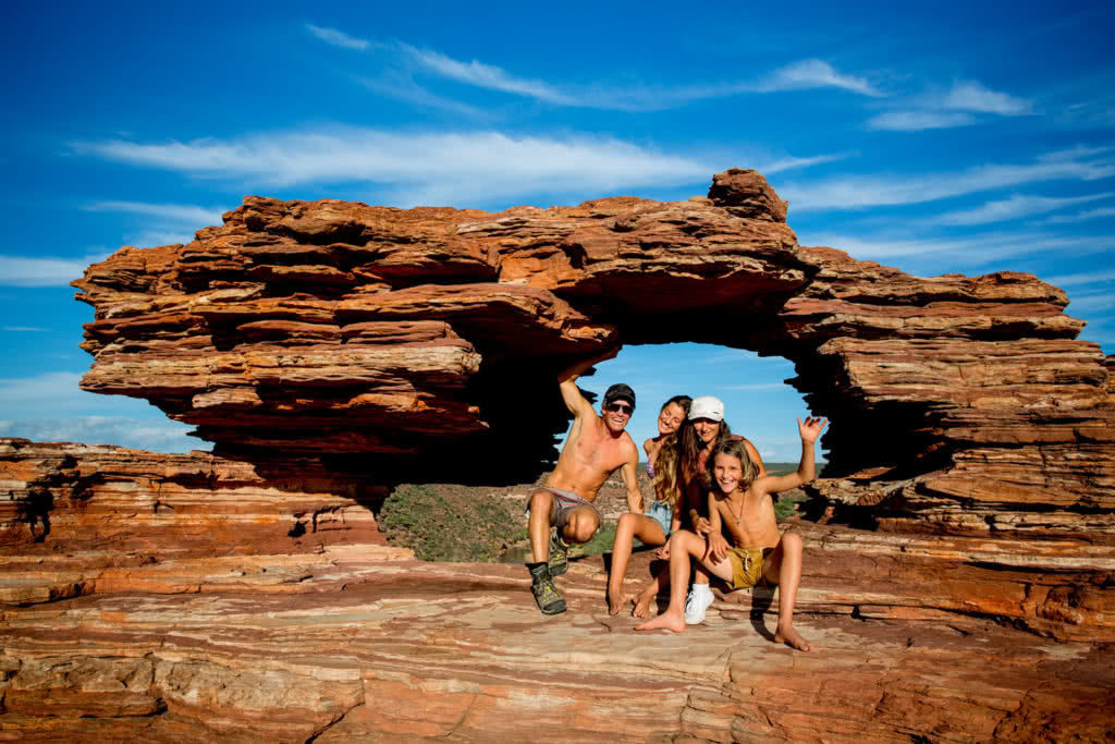 These Adventure Parents Are Re-Writing The Rule Book - ST Images Family Shot - rock arch