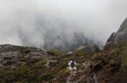 The Best of the West // Mt Murchison (TAS) Oliver Fryett mist mountain hiker poncho