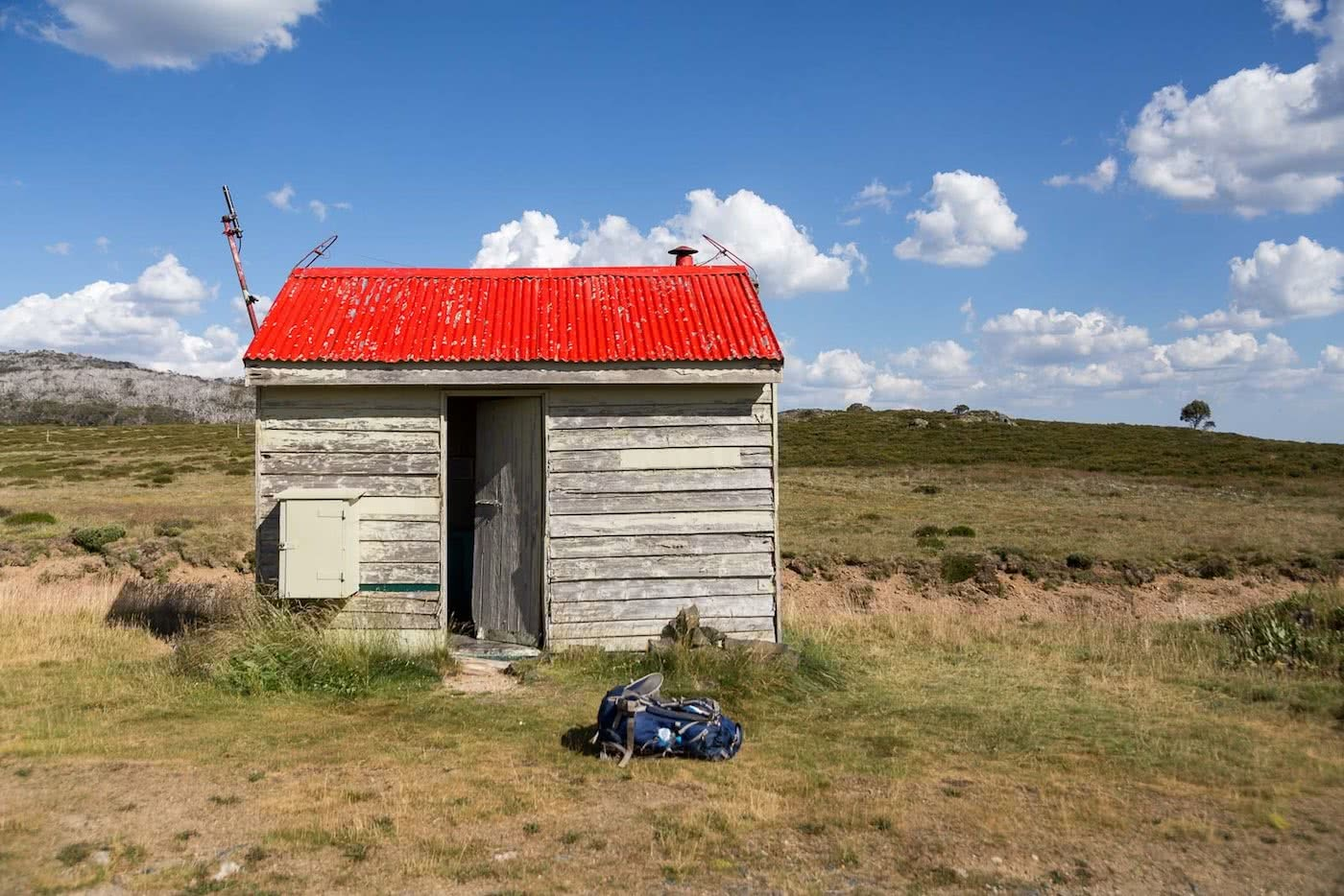 The High Plains on Foot – Four Day Falls Creek Circuit (VIC) Lachlan Fox backcountry hut, red tin roof
