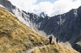 Gillespie Pass Circuit – the Best NZ Multi-day Hike You've Never Heard Of Aidan Howes, photo by Sonja Saxe hiker, orange backpack, mountain