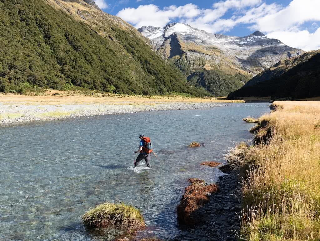 Gillespie Pass Circuit – the Best NZ Multi-day Hike You've Never Heard Of Aidan Howes, photo by Sonja Saxe hiker, backpack, river crossing,