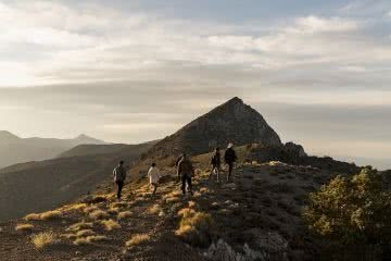 Airbnb Adventure, by Jack Brookes, photo by Airbnb, hiking, sunrise, mountain top