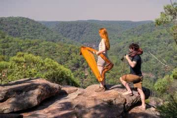 This Couple Is Thru-Hiking Between Concerts Across NZ, Mickey and Michelle, photo by Daniel Di Biase, harp, fiddle, blue mountains