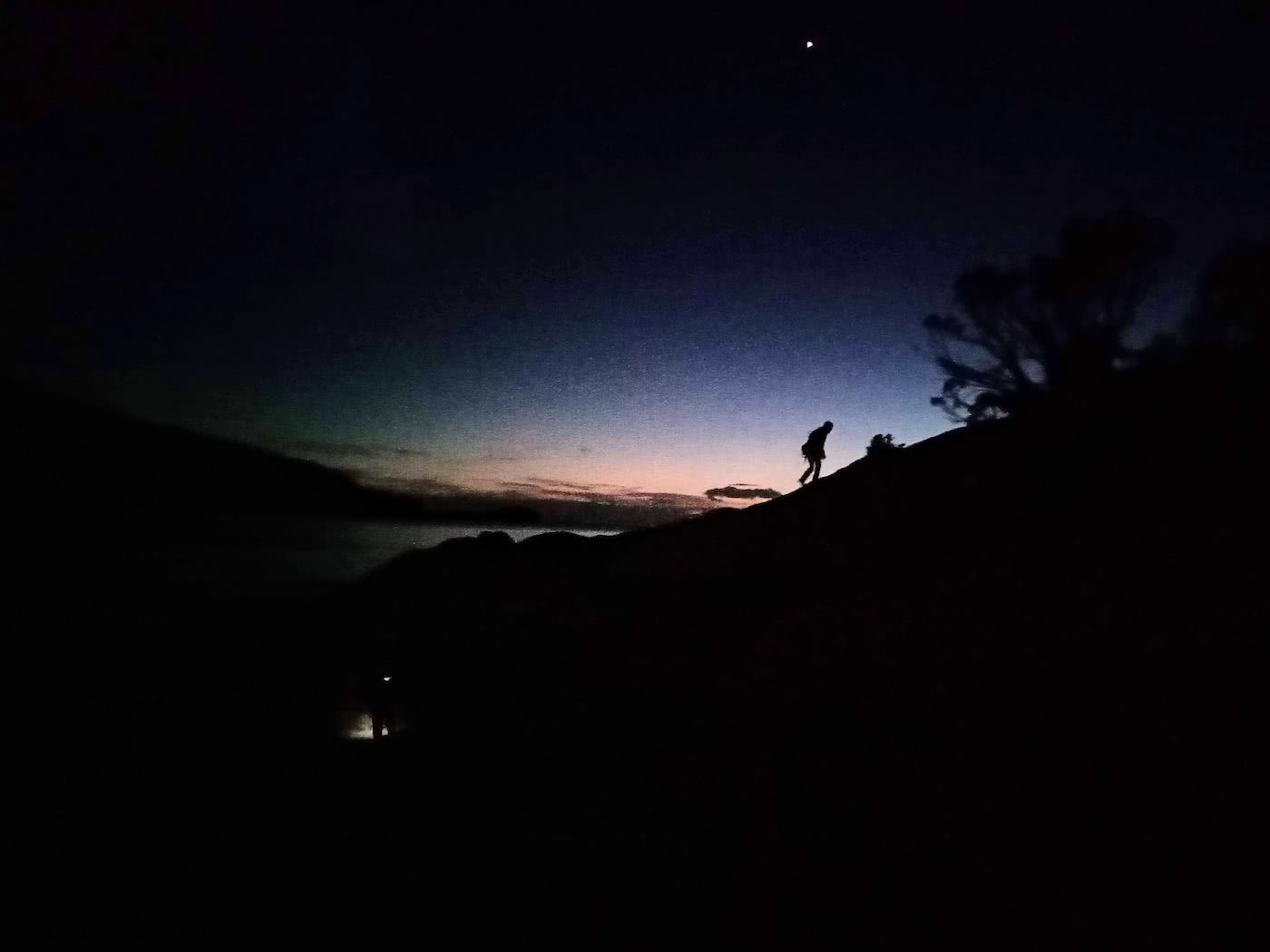 Searching for redemption on the Freycinet Sea Level Traverse, by Polly Barr, sunrise, silhouette of climber