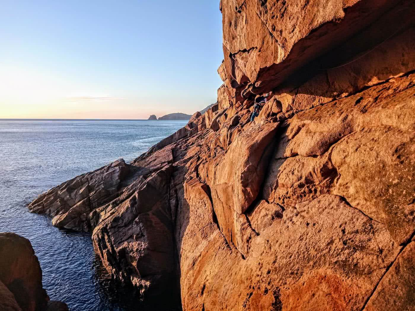 Searching for redemption on the Freycinet Sea Level Traverse, by Polly Barr, sunrise, climber