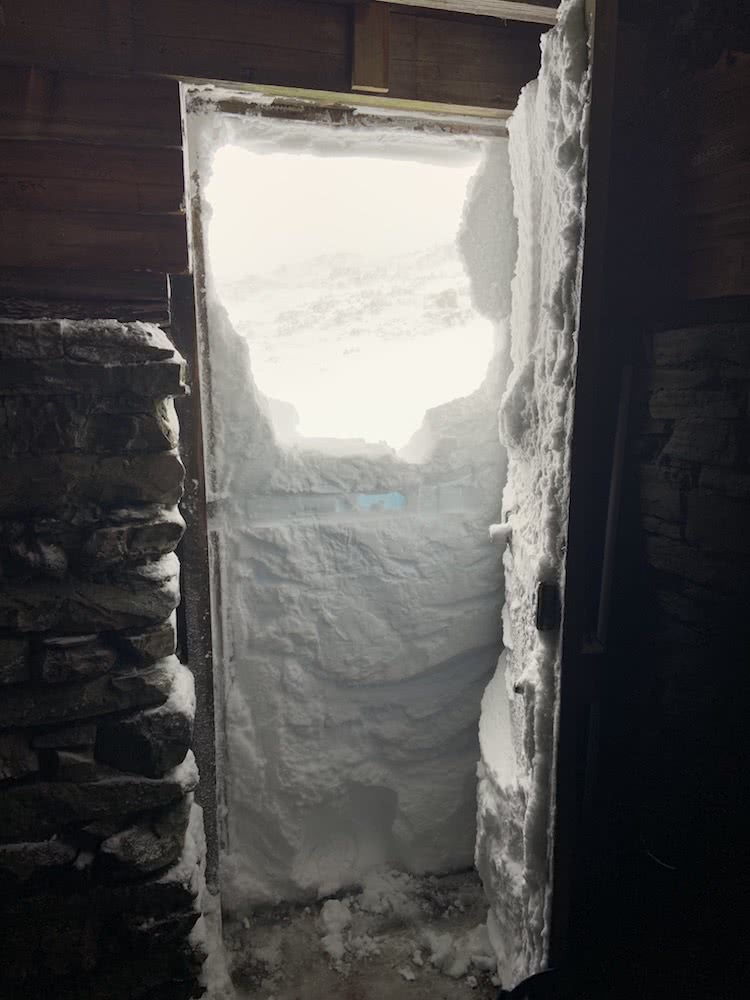 You Can Walk The Overland Track For Free (But There's A Good Reason), photo by Dom Douglas, overland track, cradle mountain lake st clair, multi day hike, snow, tasmania, doorway, snowed in