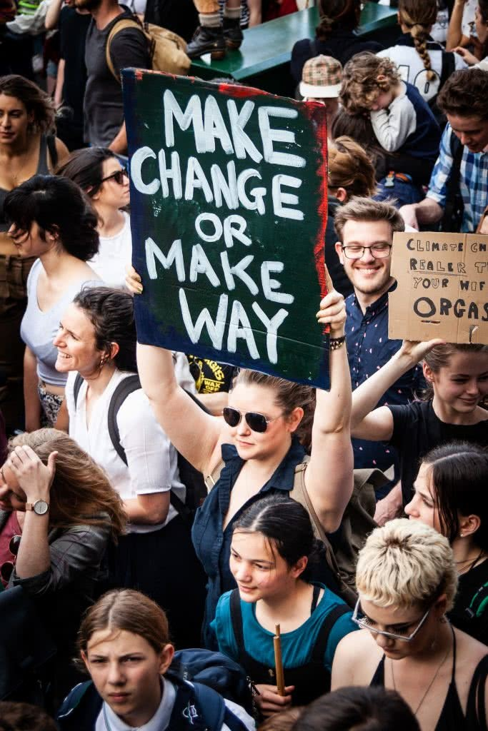 Climate Action Doesn't Stop Here – Write To Your Local Representative, photo courtesy of School Strike For Climate, sign, crowd, woman, protest