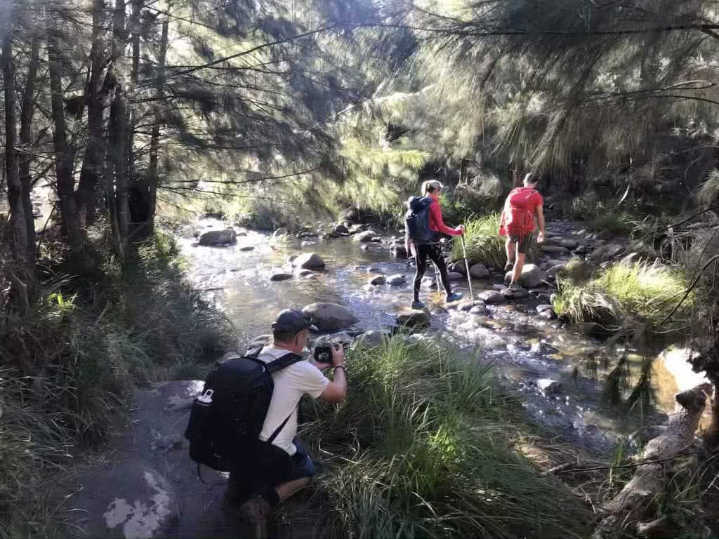 Photos courtesy of Q10 expedition, Exploring Queensland's 10 Great Walks in 10 Days, cameraman, river, man, woman, crossing, bush