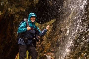 Miranda Fittock, I Tested A Full Kit Of Cheap ALDI Hiking Gear Over Nearly 100km, woman, jacket, Waterfall, thumbs up