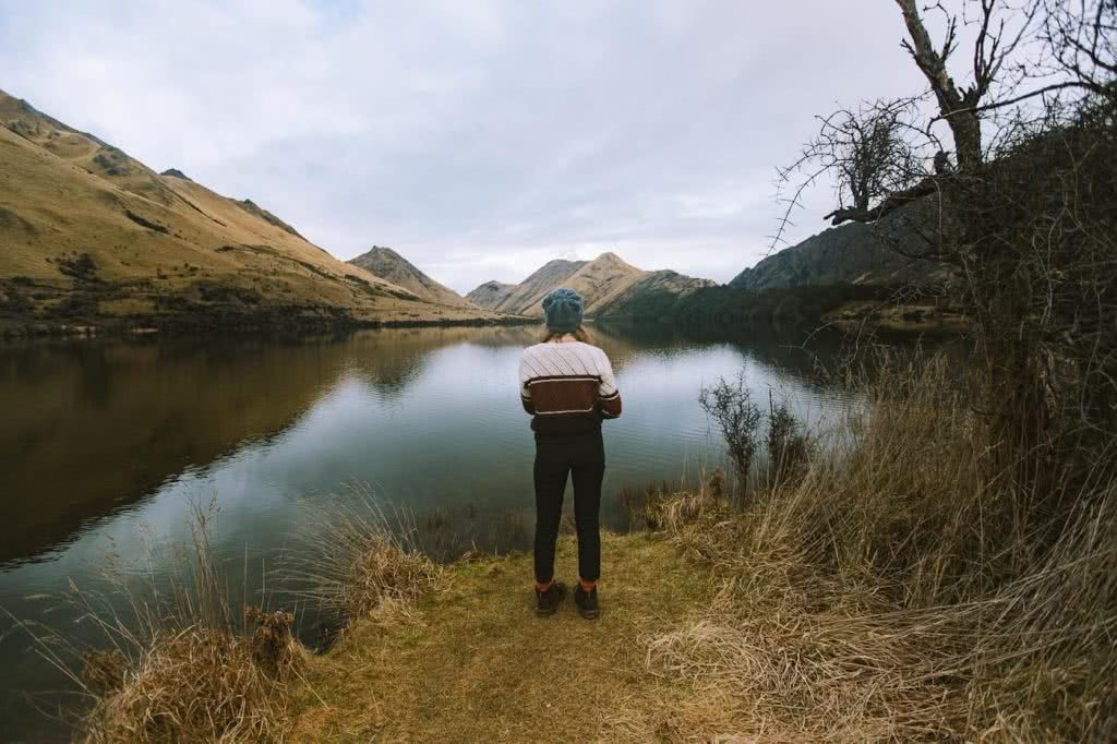 6 Hikes in New Zealand's South Island We Bet You Haven't Heard Of, Cedric Tang, woman, lake, mountains, beanie