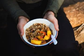 The Three Bear's Tip 'n' Mix Porridge // Camp Kitchen, Jonathan Tan, porridge, oats, peach, hands, bowl