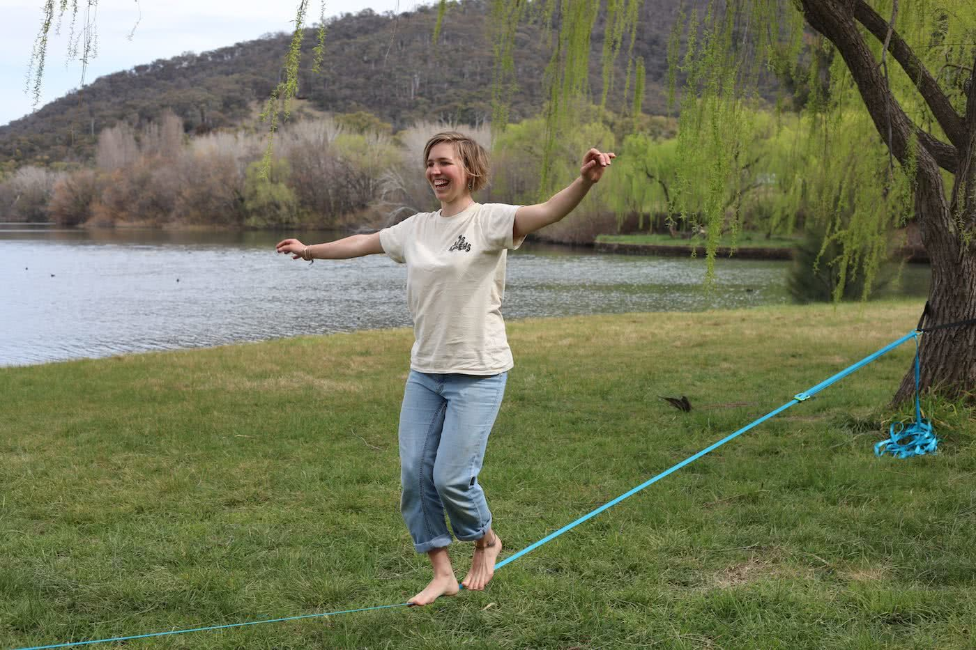 How To Squeeze More Outdoors Time Into Your Workday by Mattie Gould Smiling and slacklining in Canberra