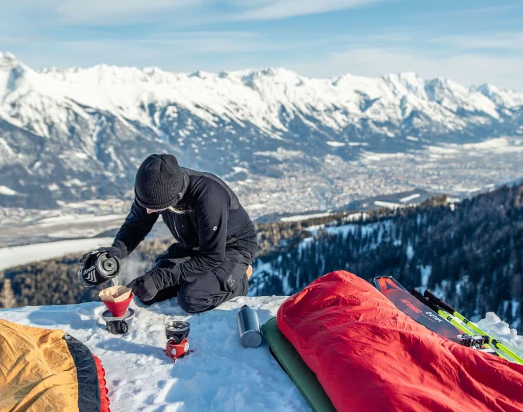 Check Out These Epic Views And Delicious Brews, Tim Sanderson, Innsbruck, sleeping bag, coffee, mountains, snow