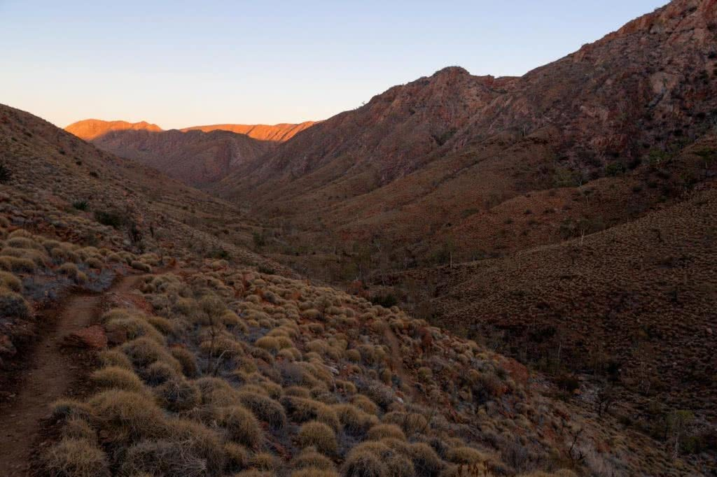 Capturing The Landscapes Of The Larapinta, Conor Moore, photo 8, rocky saddle, sunset, dusk, cliff, tussocks, red dirt, desert