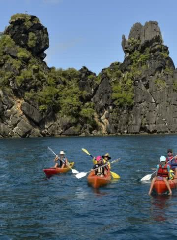 How Much Do You Really Know About New Caledonia?, photo supplied by New Cal tourism, kayak, sea, family, rocks, cliffs