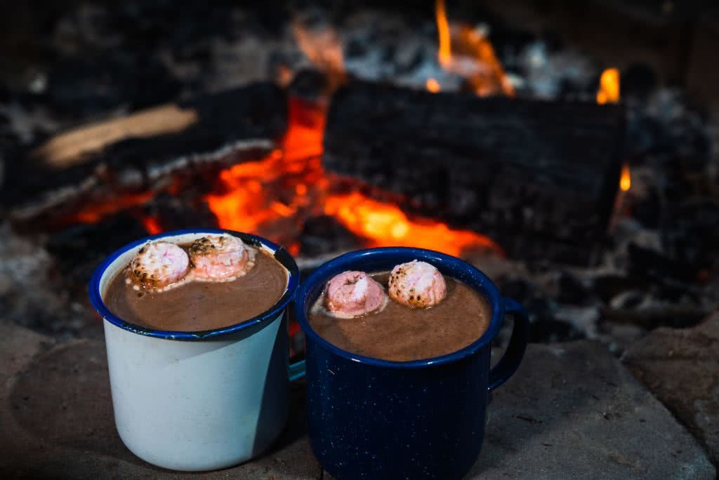 This Boozy Hot Choccy Is The Perfect Nightcap For Camping, photo Jonathan Tan, fire, campfire, hot chocolate, marshmallows, cup, mug