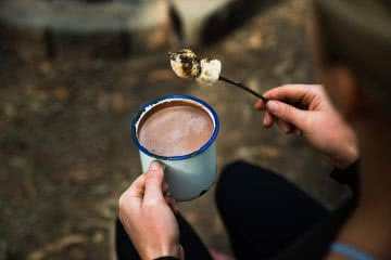 This Boozy Hot Choccy Is The Perfect Nightcap For Camping, photo Jonathan Tan, stick, marshmallows, hand, hot chocolate, woman