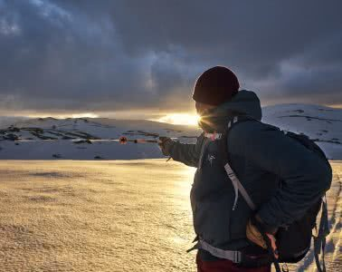 Arc'teryx Proton LT Review, Pat Corden, skier, jacket, sunset, snow, mountains, point