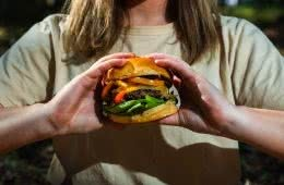 Get Your Mouth Around This Egg-In-A-Hole Burger, photo by Jonathan Tan, burger, woman, hands, shirt