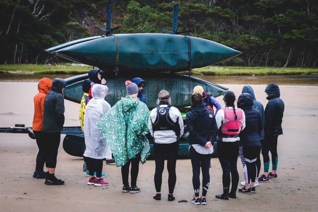 Why Do We Need Women Only Adventure Events?, photo by (), group shot, kayaks, rain, raincoats
