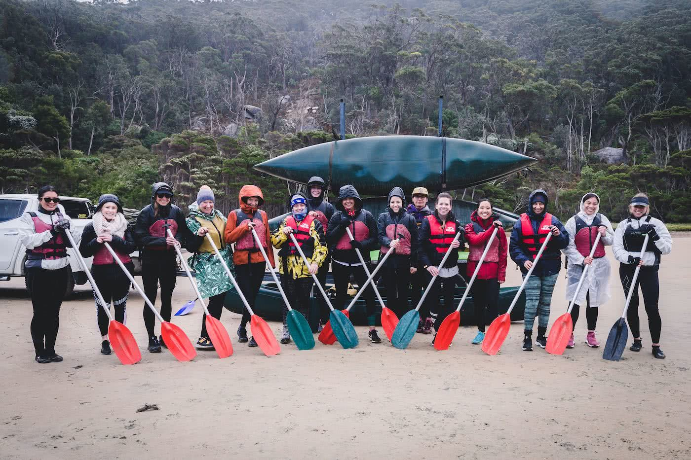 Why Do We Need Women Only Adventure Events?, photo by (), kayaks, paddles, group, women, rain, raincoats