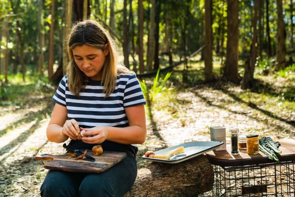 Grab Your Sporks! We're Indulging In A Week Of Camp Cooking, photo by Jonathan Tan, woman, ingredients, chopping board, bush, trees