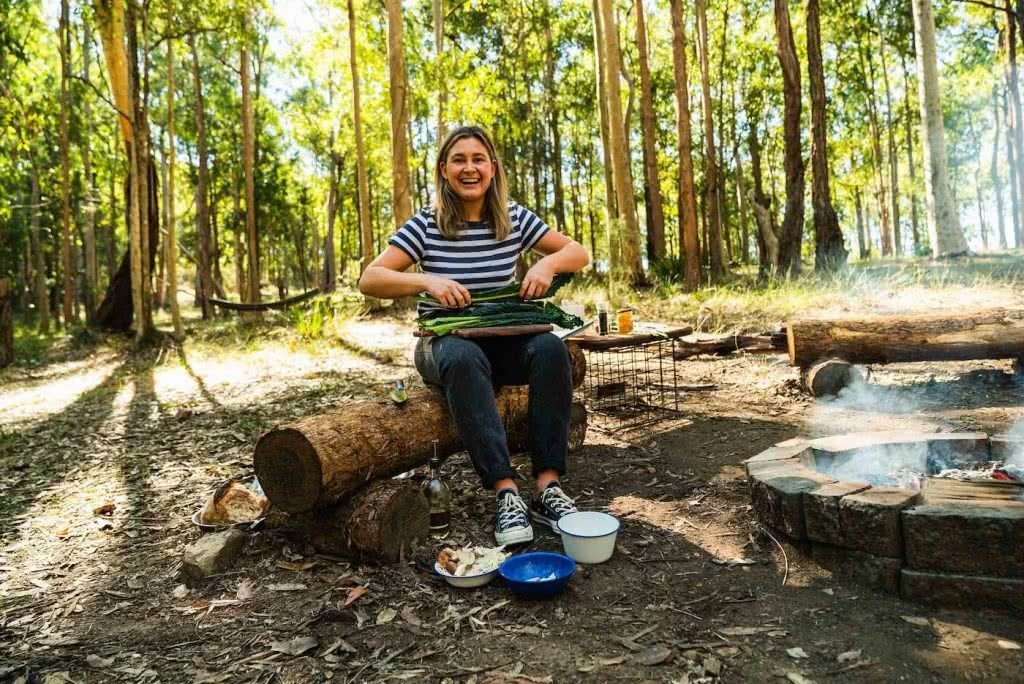 Feed The Camping Masses With This Crispy Eggy Breaky, photo by Jonathan Tan, kale, woman, bush, trees, fire