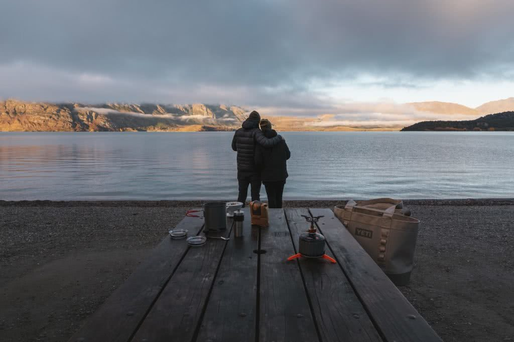 Check Out These Epic Views And Delicious Brews, Rich Gibbons, couple, coffee, bench, lake, mountains