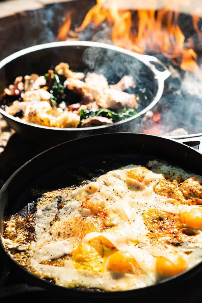 Feed The Camping Masses With This Crispy Eggy Breaky, photo by Jonathan Tan, fry pans, skillet, fire, flames, eggs, breakfast