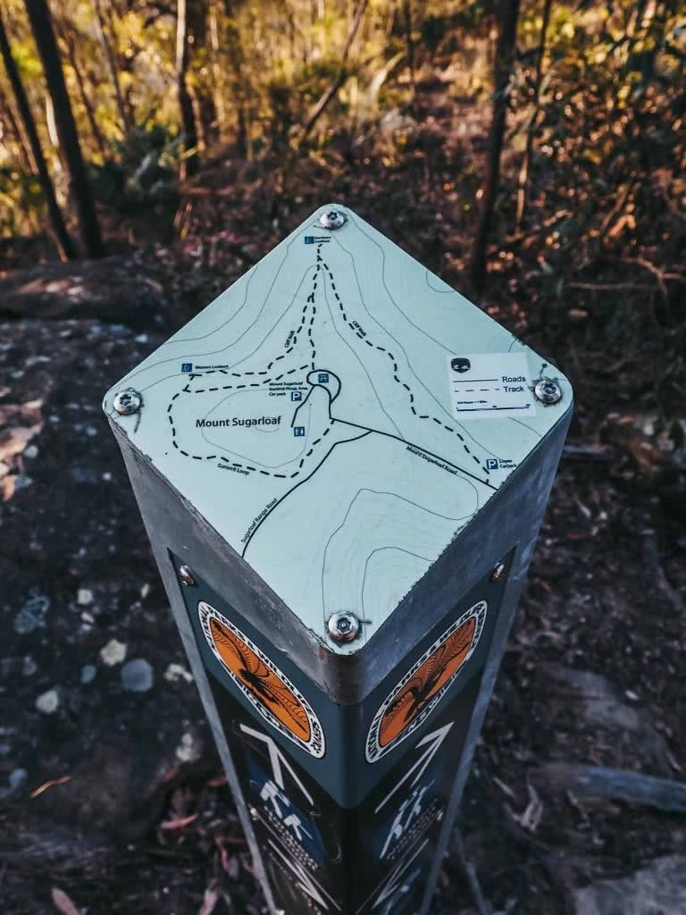 Escape The Rat Race With A Cheeky Weekend In Lake Macquarie, photo by Damon Tually, map, signpost, Sugarloaf Mountain