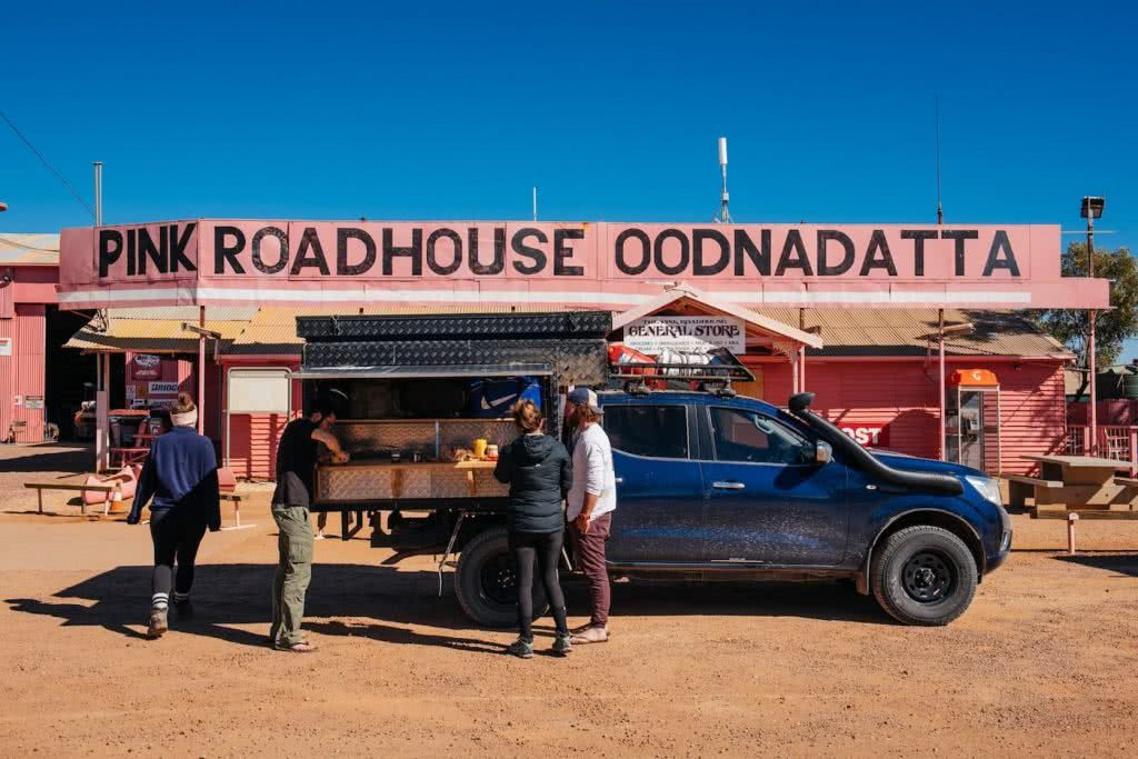 How To Drive From Adelaide To Uluru The Explorer's Way, Adrian Mascenon, Pink Roadhouse Oodnadatta, ute, desert, people, road trip