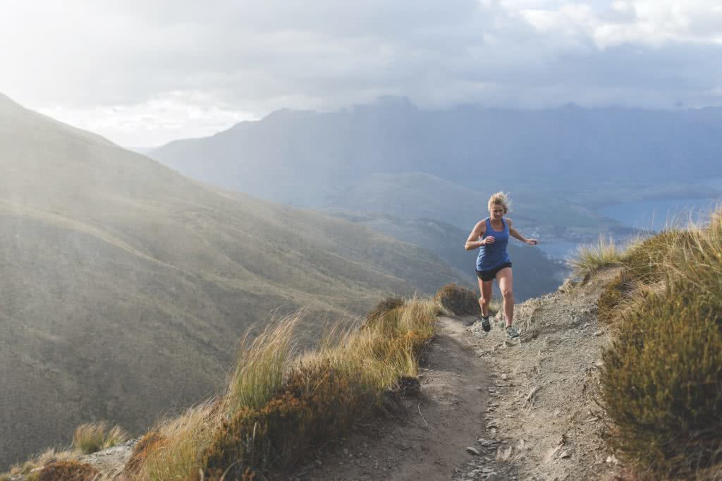 7 Weird Ways You Can Help Save the Planet, photo supplied by Icebreaker, woman, running, t-shirt, mountains, New Zealand