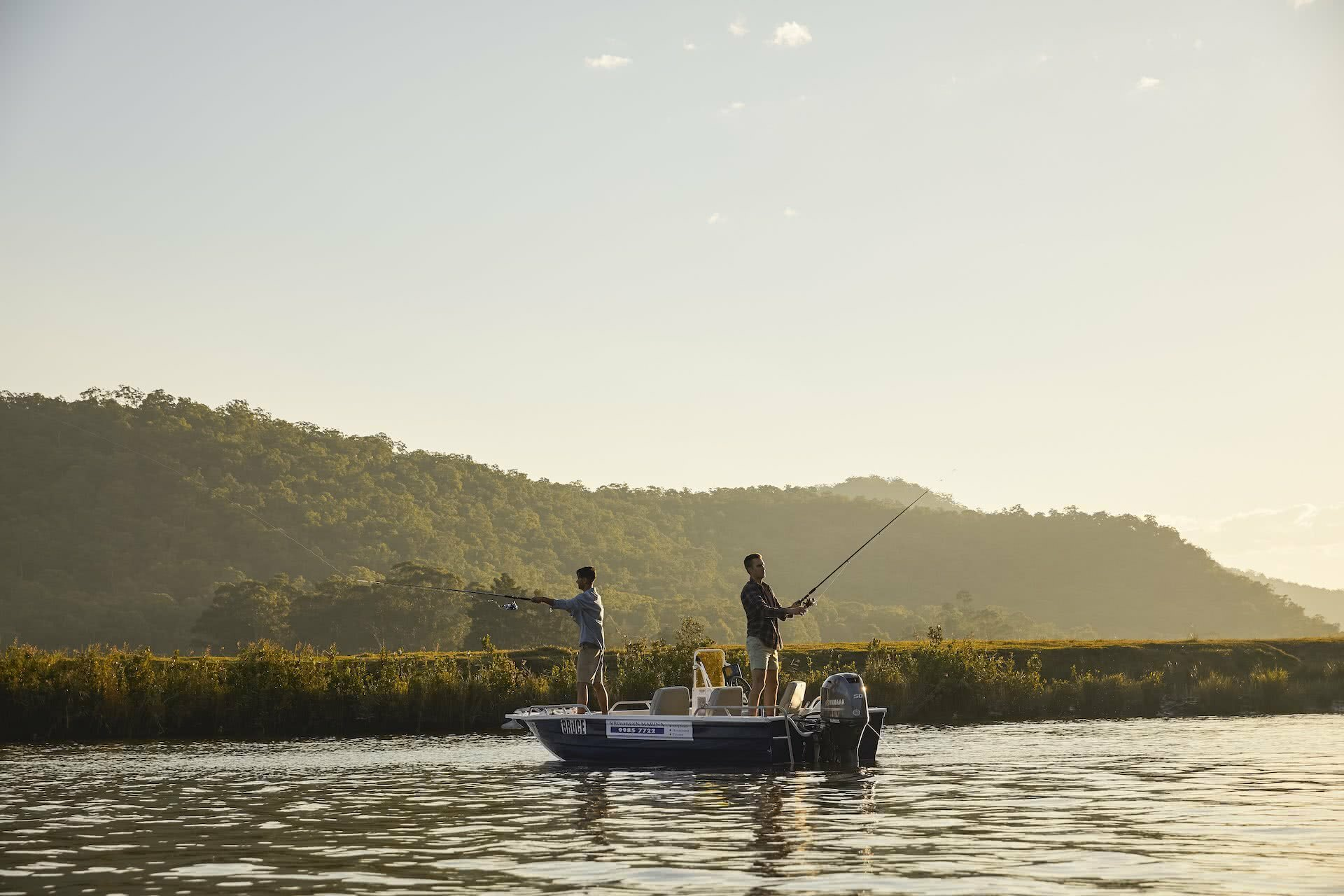 Best Fishing Spots In Sydney, photo thanks to DNSW, men, fishing, boat, Hawkesbury River, sunset, Wisemans Ferry, friends