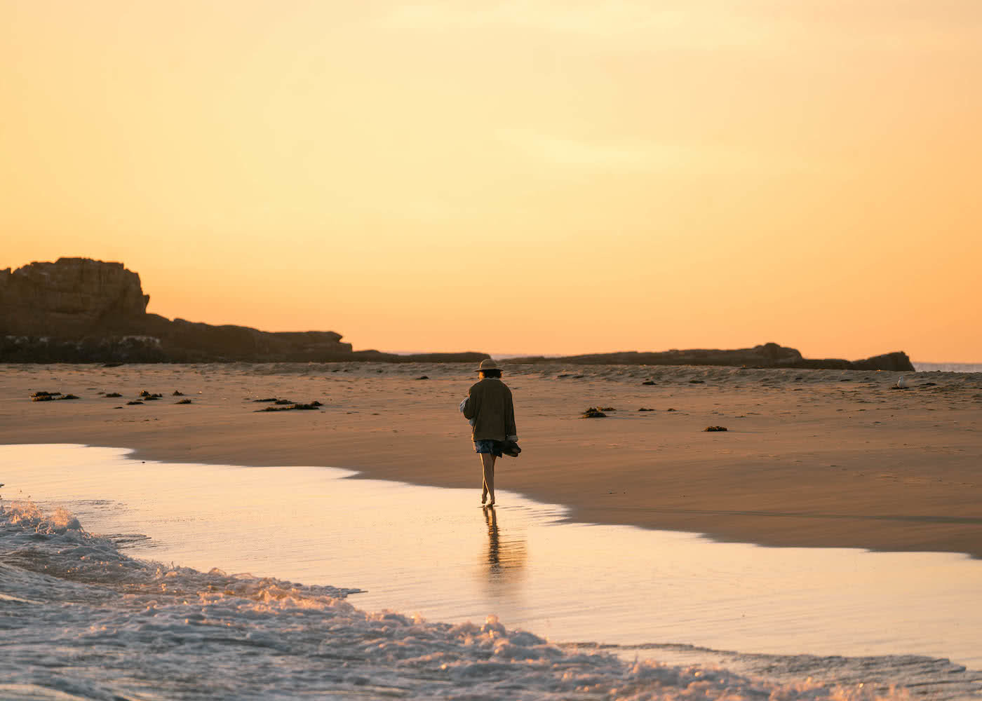 8 Great Reasons To Take Your Mates To Eurobodalla, photo by Fin Matson, Mystery Bay, sunset, orange sky, walking, beach reflection