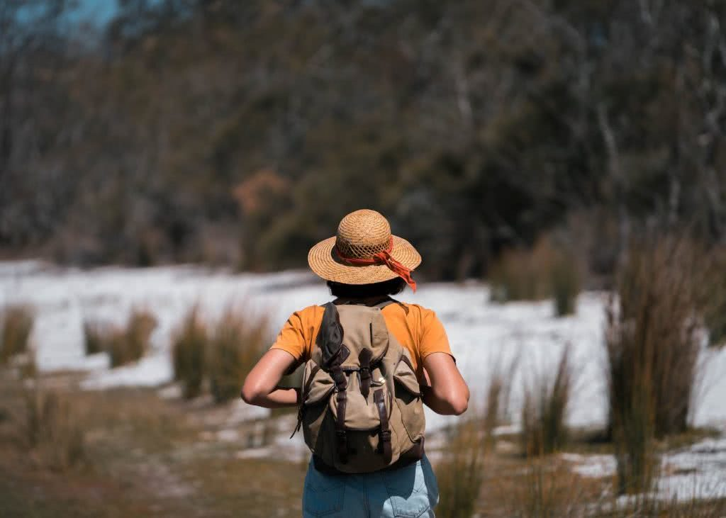 Step Back In Time Along The Bingi Bingi Dreaming Track // Eurobodalla (NSW), photo by Fin Matson, woman, hat, hiking, sand, reeds