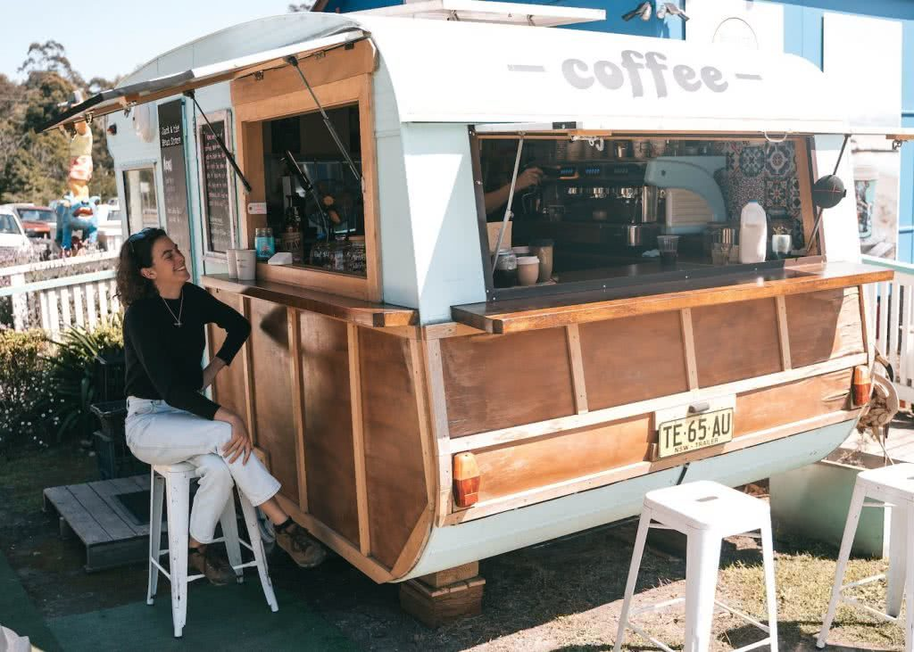 8 Great Reasons To Take Your Mates To Eurobodalla, photo by Fin Matson, Mogo, coffee shop, woman, laugh, caravan