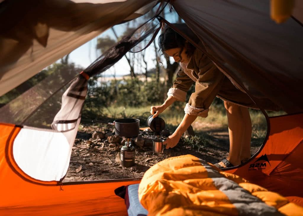 8 Great Reasons To Take Your Mates To Eurobodalla, photo by Fin Matson, tent, coffee, beach, woman, sleeping bag, view