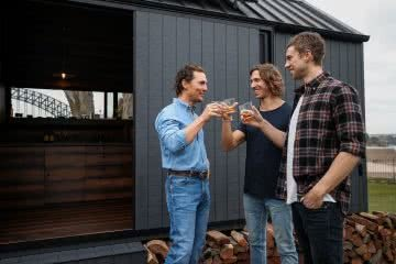 What Do Matthew McConaughey, Unyoked & Wild Turkey Have In Common?, photo courtesy of Getty Images/ Wild Turkey, Matthew McConaughey, Chris and Cam Grant, cabin, bourbon whiskey