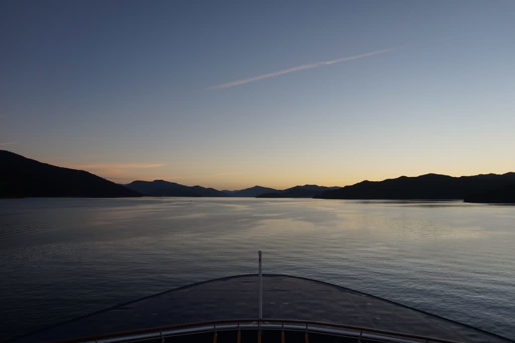 Make New Zealand Your Next Solo Road Trip Destination, Amy Fairall, sunset, boat, water, ferry