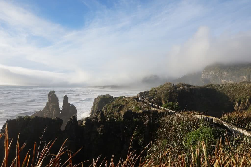 Make New Zealand Your Next Solo Road Trip Destination, Amy Fairall, Pancake Rocks, West Coast, sea, mountains, cliffs, fog, rainforest