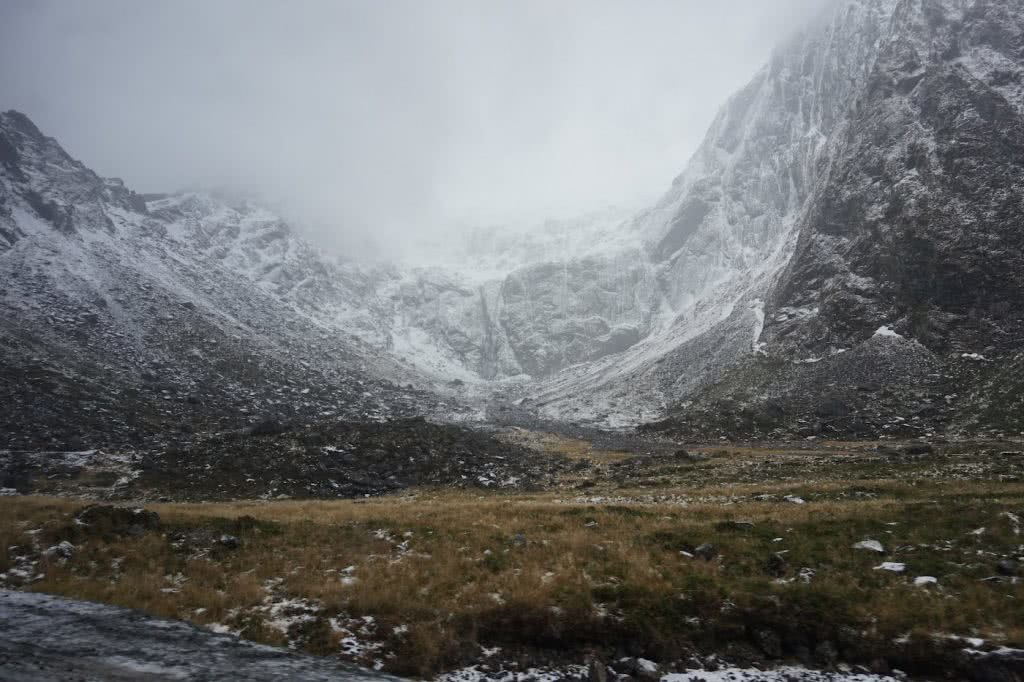 Make New Zealand Your Next Solo Road Trip Destination, Amy Fairall, mountains, Milford Sound, snow, mist