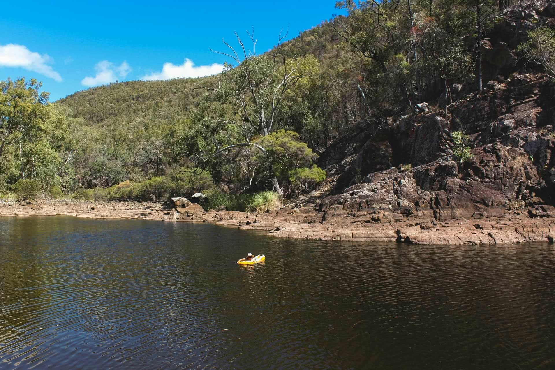Sun-up to Sundown National Park – The Mt Donaldson Circuit (QLD), Saphira Schroers, photo by Mitchell Quinn, Floating on Permanent Waterhole, swimming, rocks