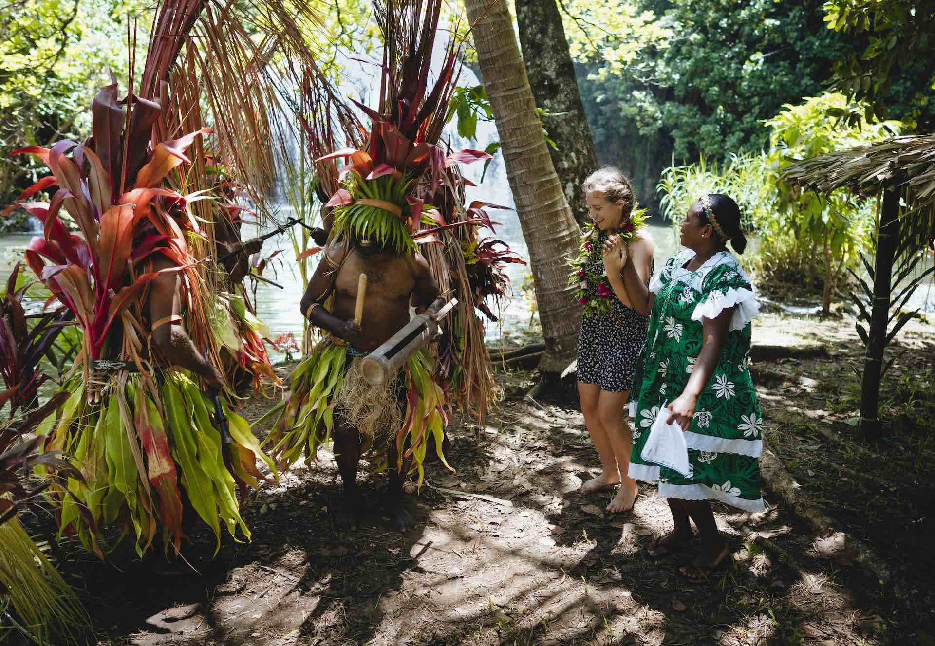10 Things You Need To Know When Travelling Vanuatu's Outer Islands, Ruby Claire, photos by Ain Raadik and Ben Savage, custom dress, dancing, palm trees, women, Maewo - Naone falls arrival dance