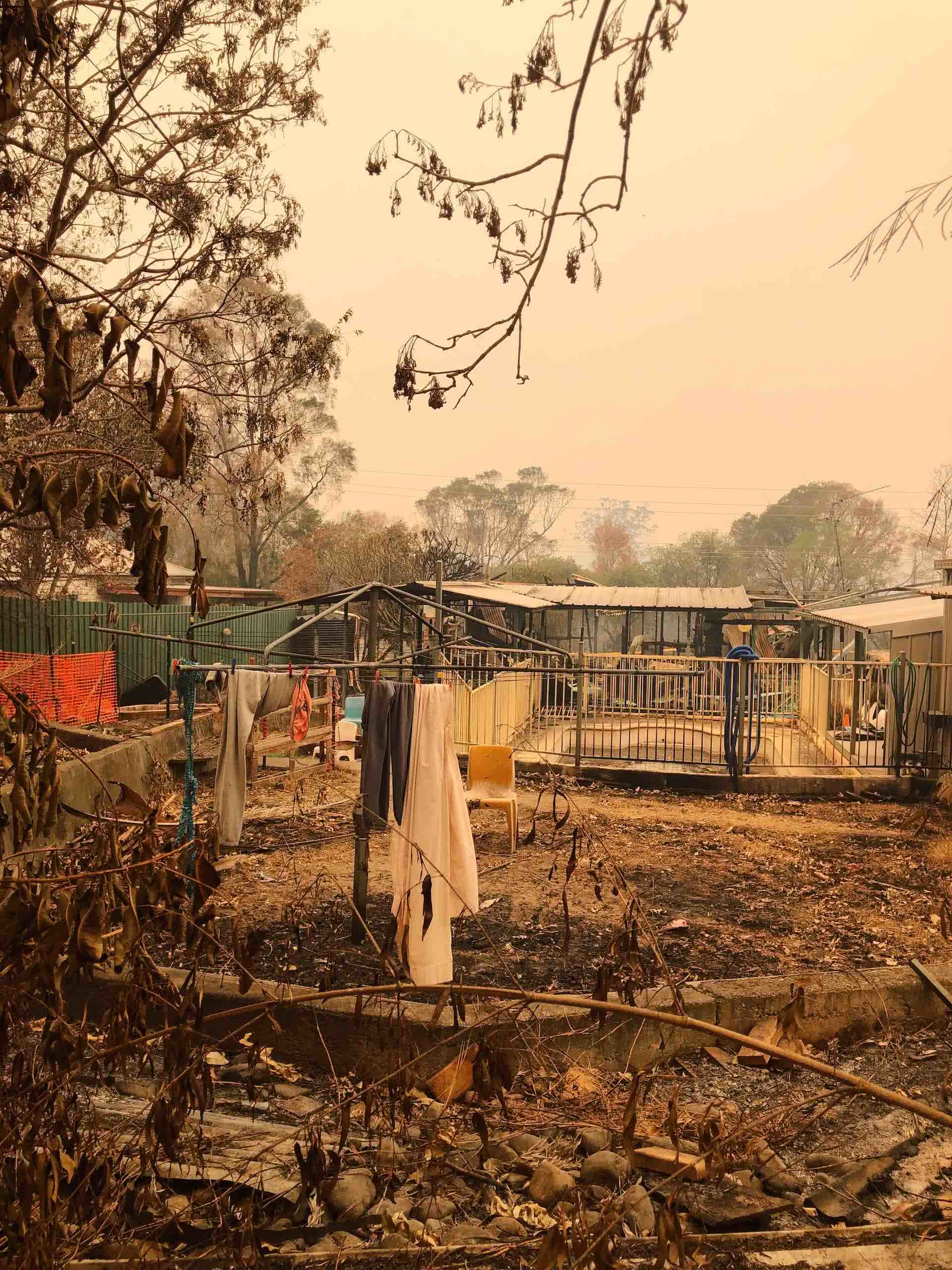 After The Flames – What Does A Bushfire Leave Behind?, Amy Fairall, photo by Anouk Berney, house, clothesline, burnt, smoke