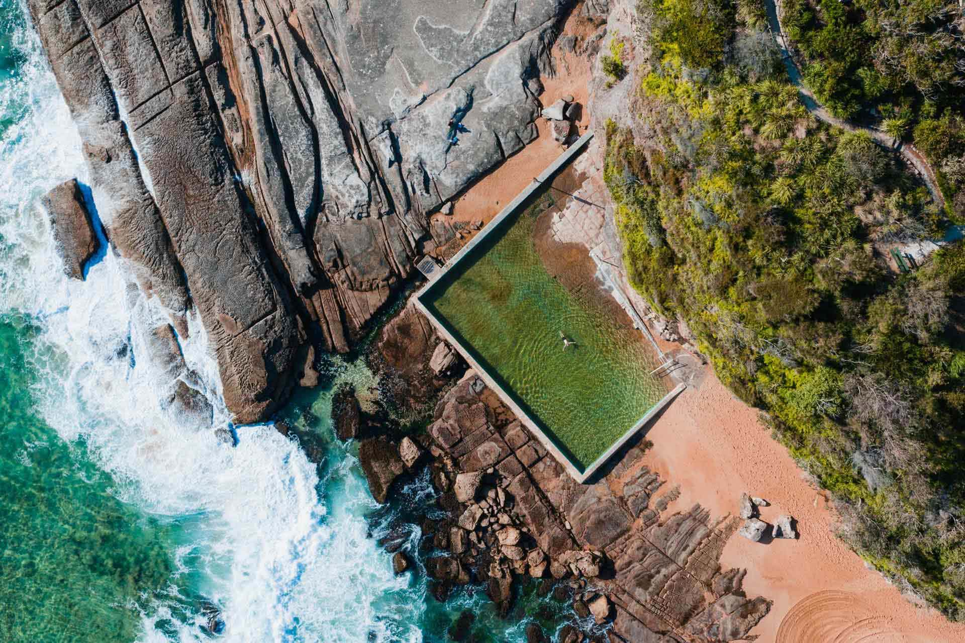 Here's All The Ocean Pools In Sydney's Northern Beaches, Jonathan Tan, Whale Beach Rock Pool, overhead shot, pool, ocean, rocks, waves, beach, sand