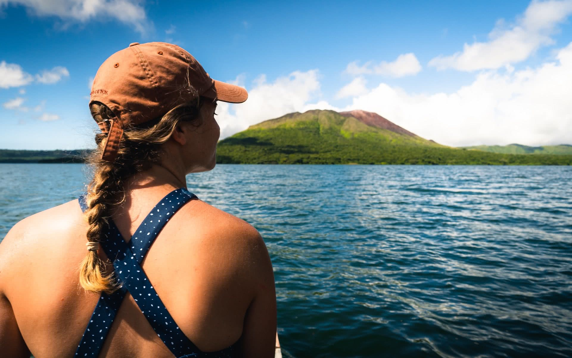 How a Visit to Vanuatu's Outer Islands Changed How I See the World, Ruby Claire, photos by Ben Savage and Ain Raadik, woman, hat, ocean, boat, island, sky, volcano, lake letas, Mt Gharat