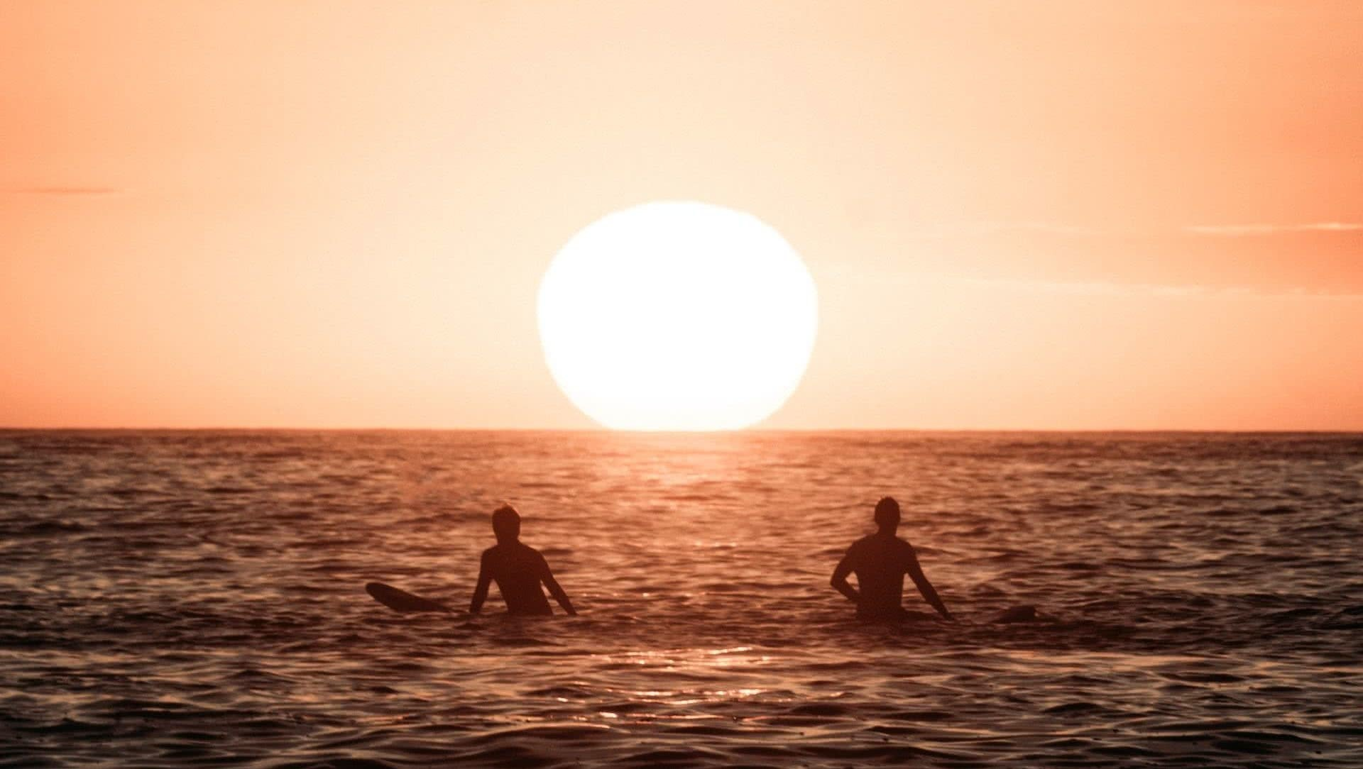 There's a Story Behind Every Photo: Adventure Photographer Fin Matson, photo by Fin Matson, Jono Tan, sunrise, beach, surfers, sun, ocean,